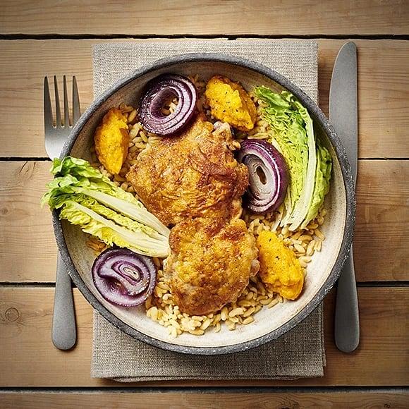 Kryddiga kycklinglår med rostad morotskräm